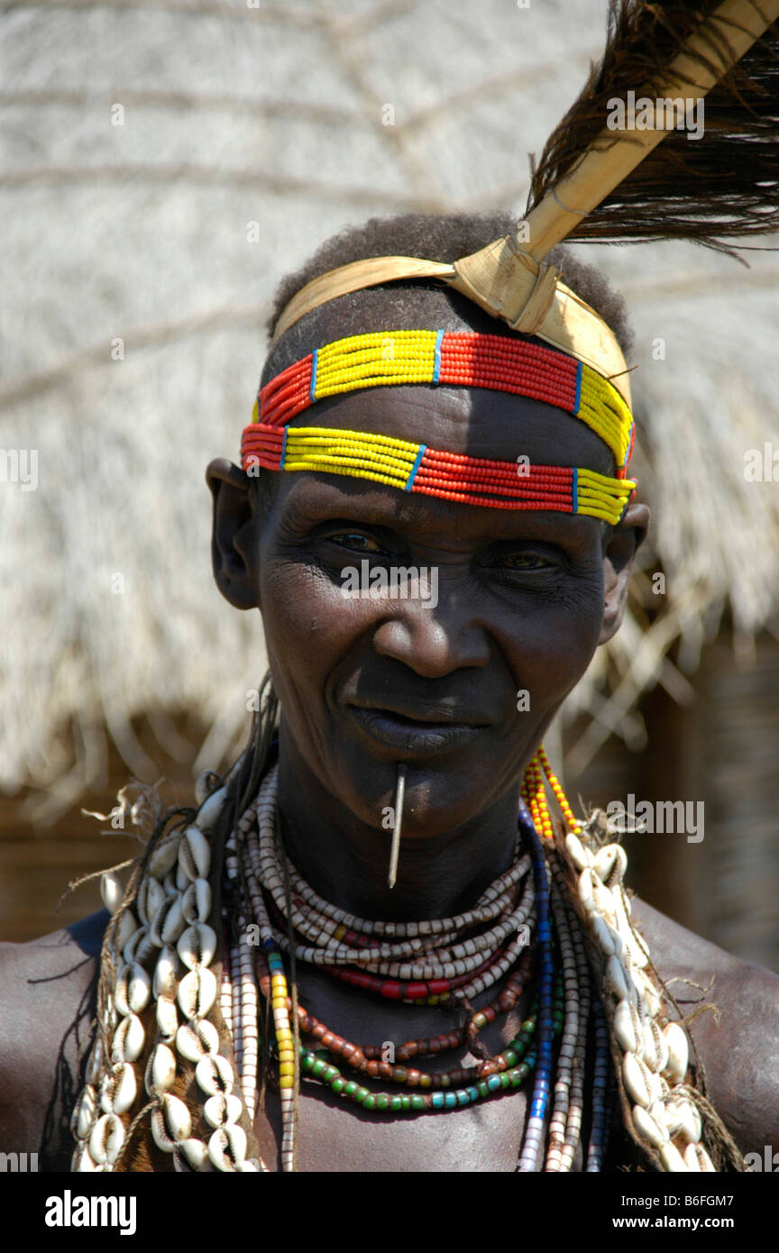 Karo tribesman wearing feathers in a colorful headband, portrait, Kolcho, South Omo Valley, Ethiopia, Africa - Stock Image