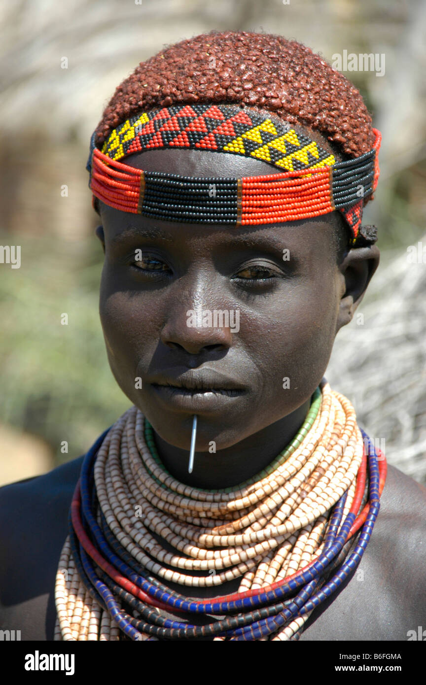 Karo tribeswoman wearing a colorful headband and clay in her hair, portrait, Kolcho, South Omo Valley, Ethiopia, - Stock Image