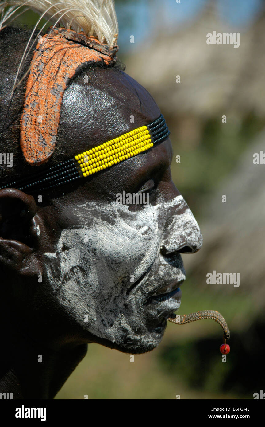 Karo chief with a white painted face, a clay headdress and colorful headband, profile portrait, Kolcho, South Omo - Stock Image