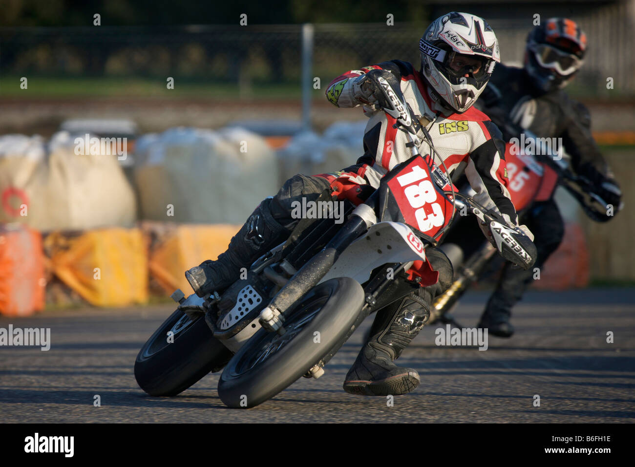 Supermoto racing drivers in oblique position - Stock Image