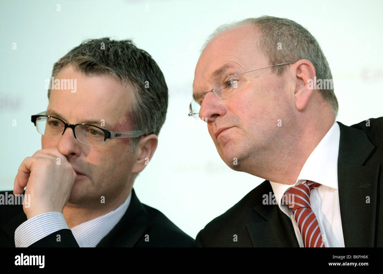 Hans-Peter Villis, chief executive of EnBW Energie Baden-Wuerttemberg AG, and Christian Holzherr, left, finance Stock Photo