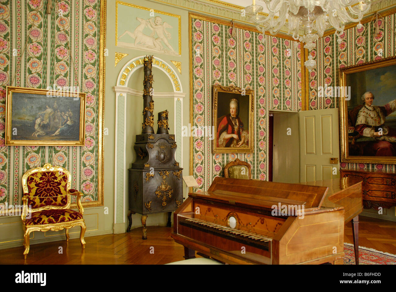 Rococo room containing a harpsichord and a wood-burning stove, in the Kurpfaelzischen Museum, Heidelberg, Baden - Stock Image