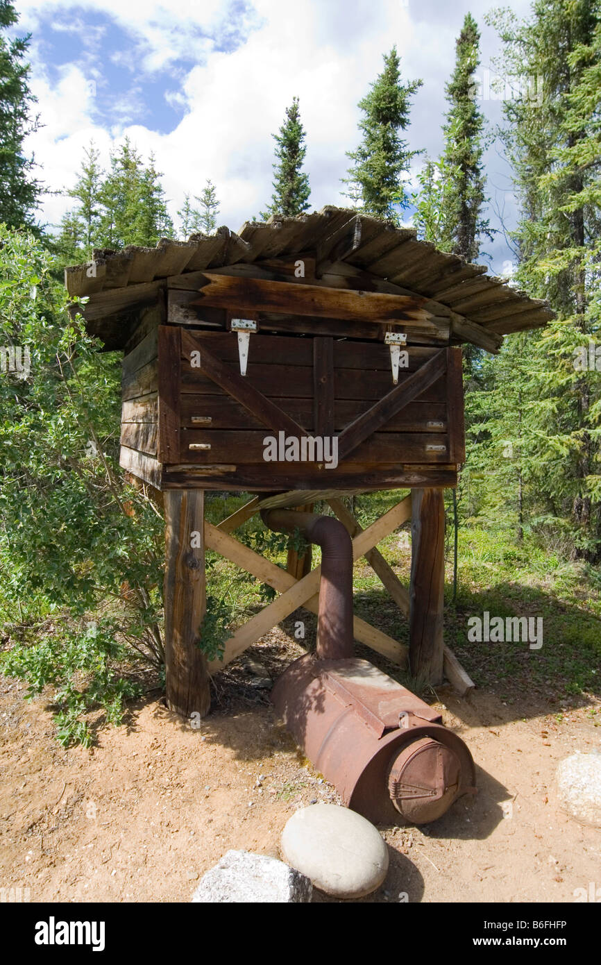 Indian log food cache, protected from bears, wood stove, Moose Creek Lodge, Yukon Territory, Canada, North America - Stock Image