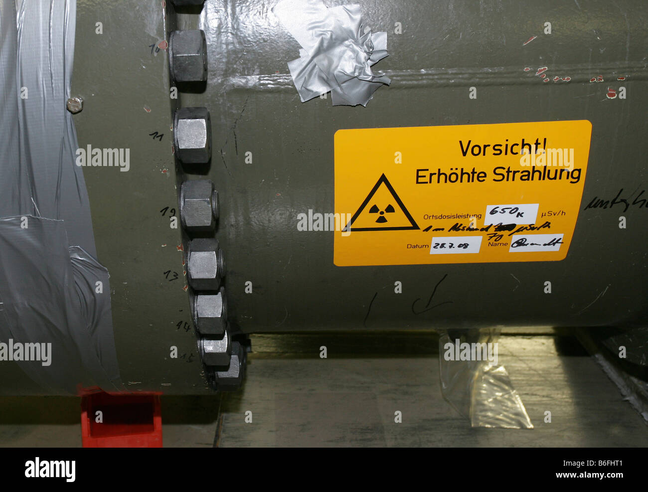 Dismantling work of the atomic energy reactor at Muelheim-Kaerlich, a sign on a dismantled heat exchanger warning - Stock Image