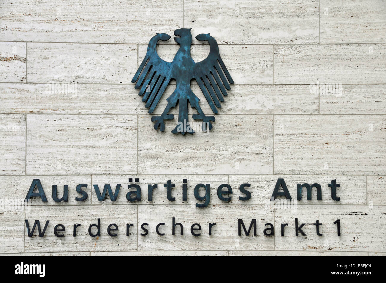 Federal Eagle and text on a sign for the Auswaertiges Amt or Department for Foreign Affairs at the Aussenministerium - Stock Image