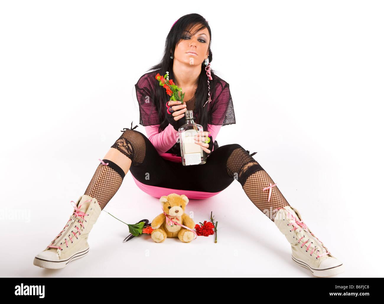 EMO girl with bottle - Stock Image