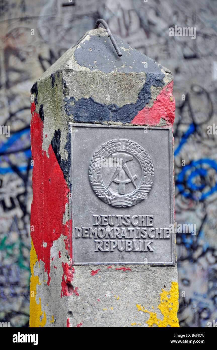 Original DDR border post in front of the Wall Museum at Checkpoint Charlie, Berlin, Germany, Europe - Stock Image