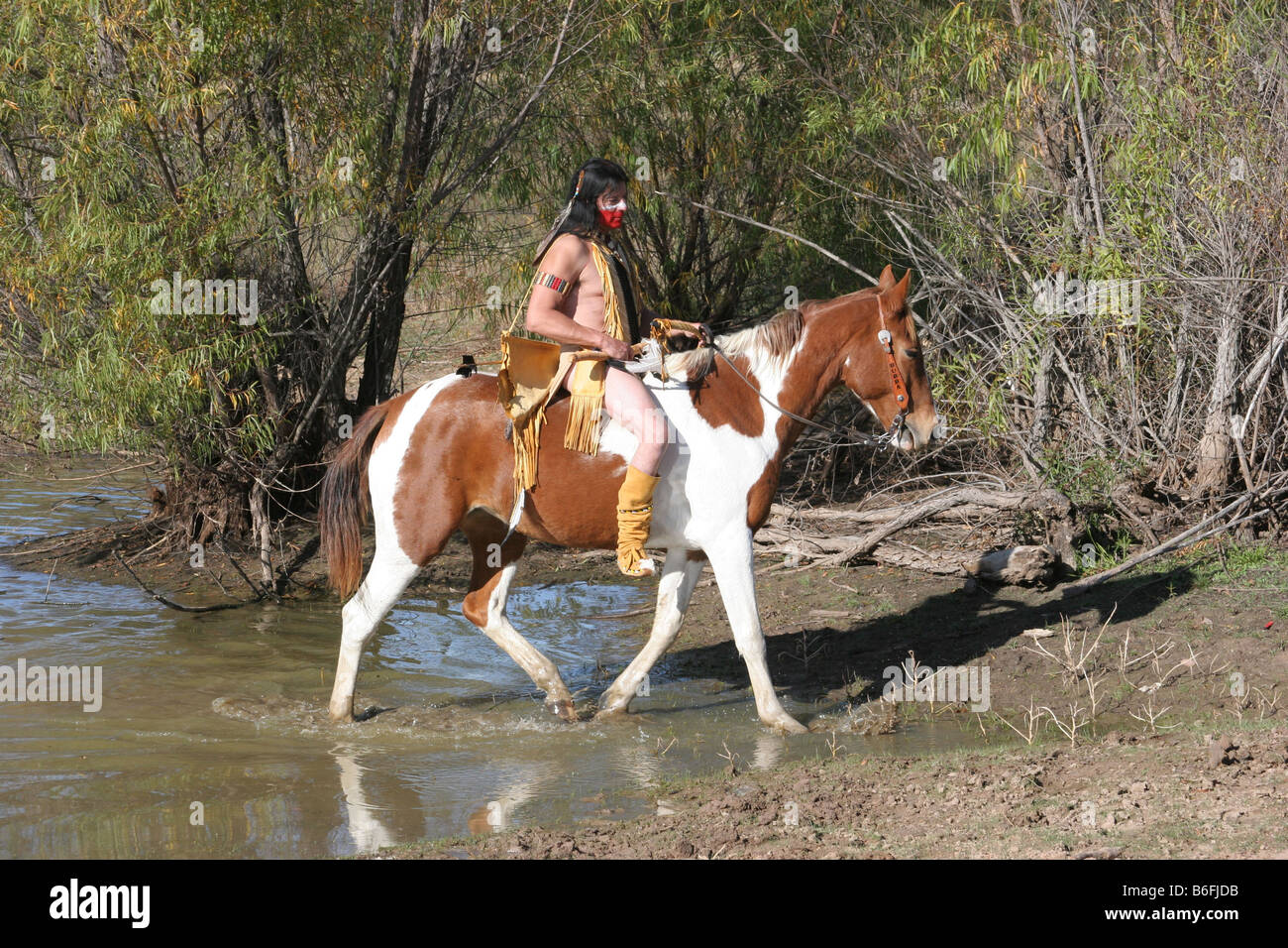 A Native American Indian man riding bareback on his horse ...