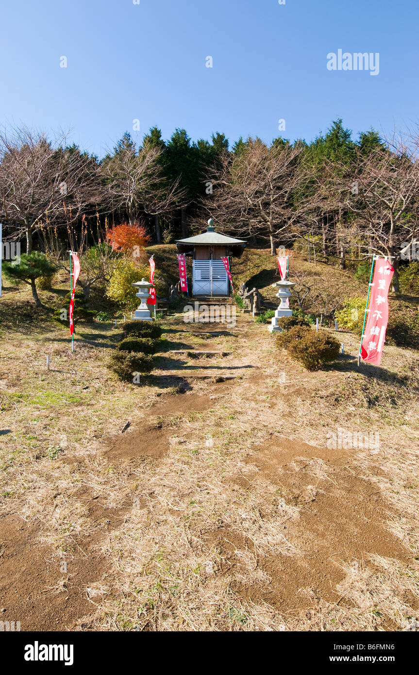 A short but steep path leads to this small shrine atop a mountain in Kanagawa prefecture Japan - Stock Image