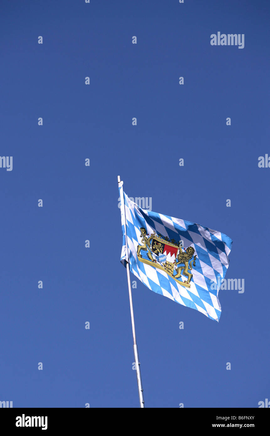 Coat of arms of the Free State of Bavaria on a chequered pattern on a flattering flag - Stock Image