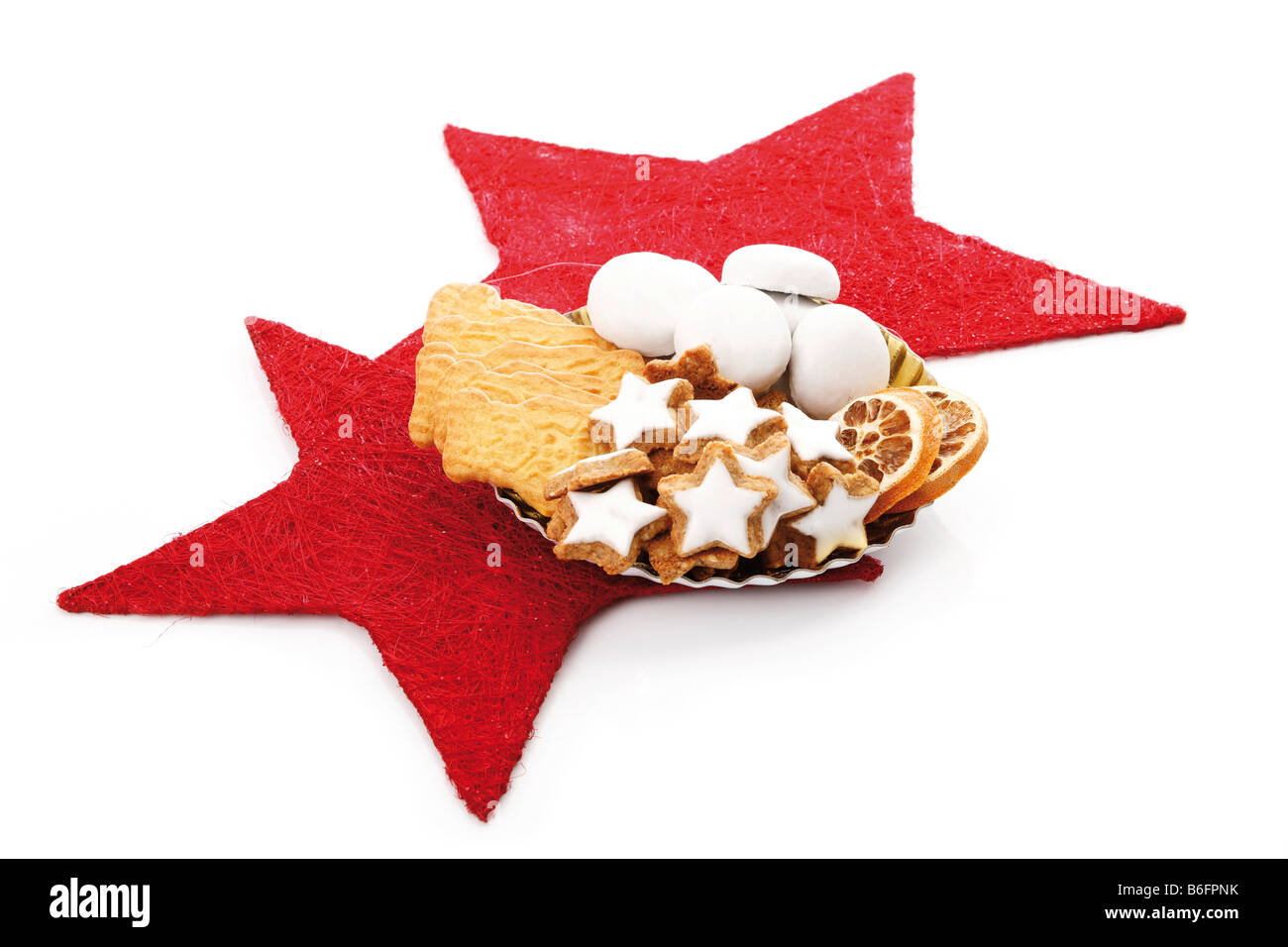 Plate Of Assortmed Christmas Biscuits On Red Stars Decoration Stock