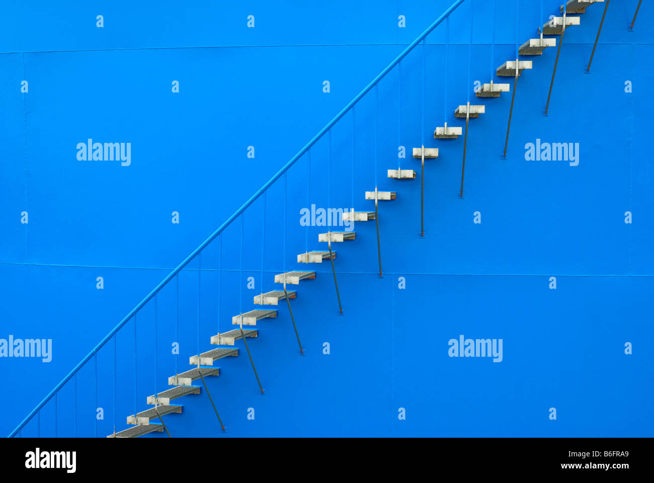 Steel staircase on the outer wall of an oil tank - Stock Image
