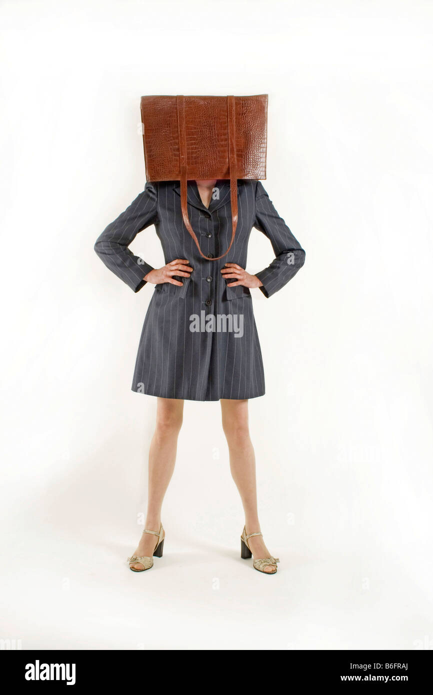 Woman with her handbag over her head - Stock Image
