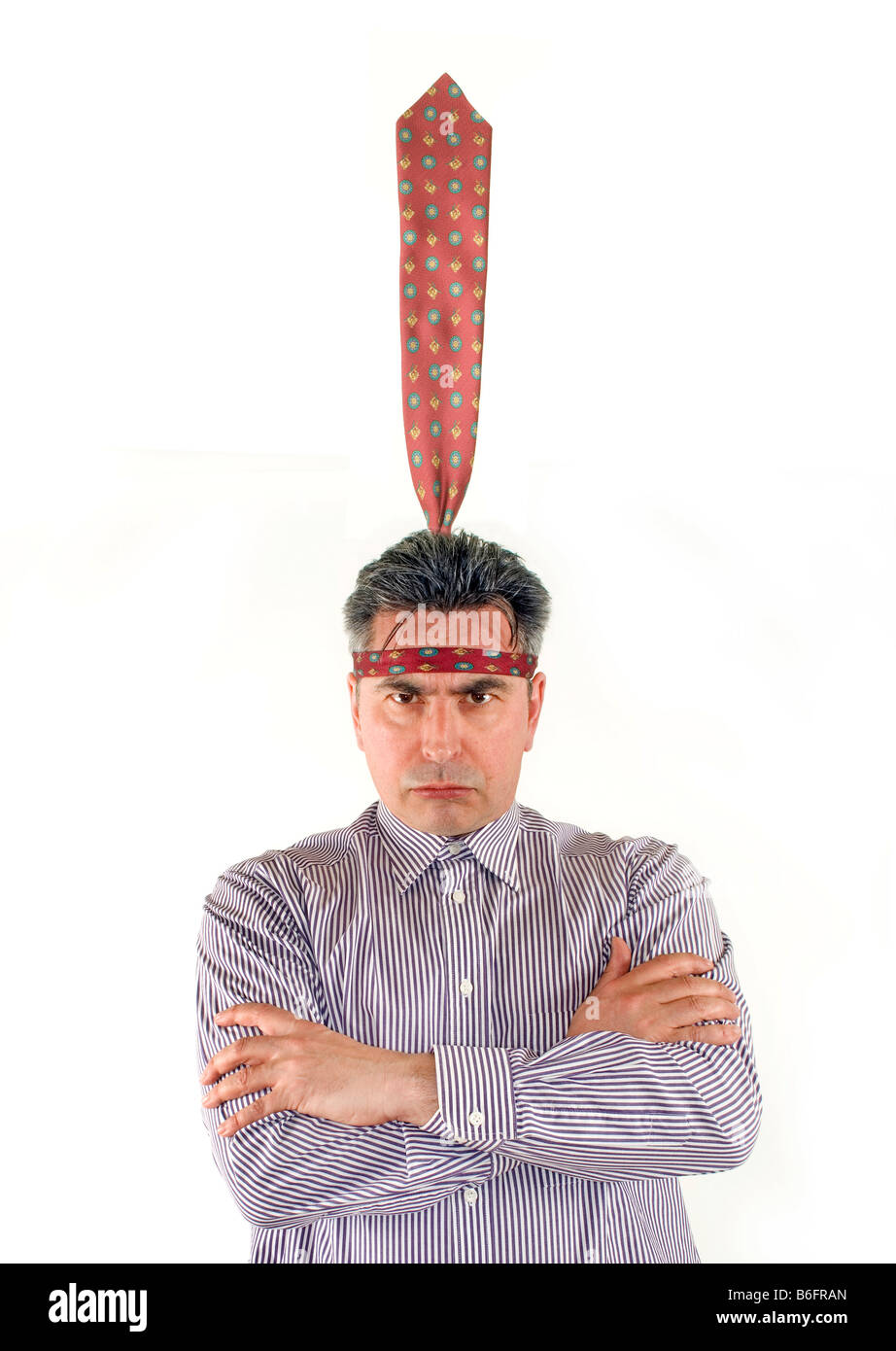Businessman wearing his tie as a headdress - Stock Image