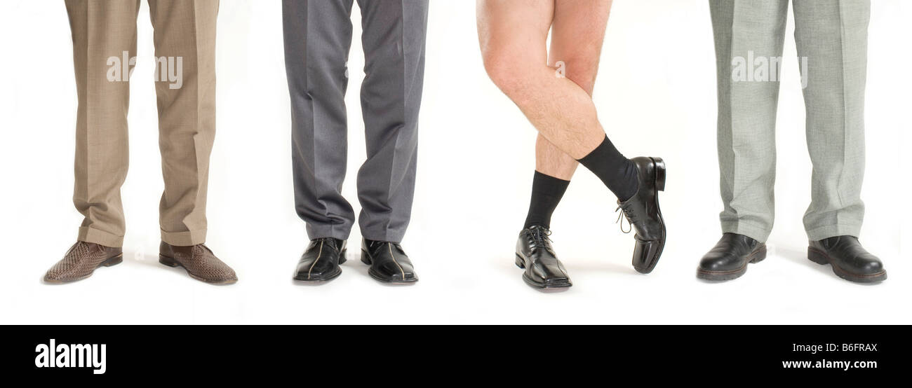 Four businessmen standing in a row, one without pants, detail of legs - Stock Image