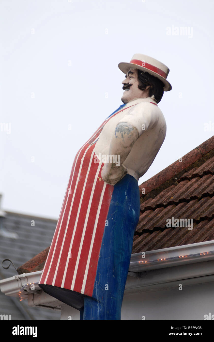 Model of a butcher outside a butcher s shop in Bedford UK 2008 - Stock Image