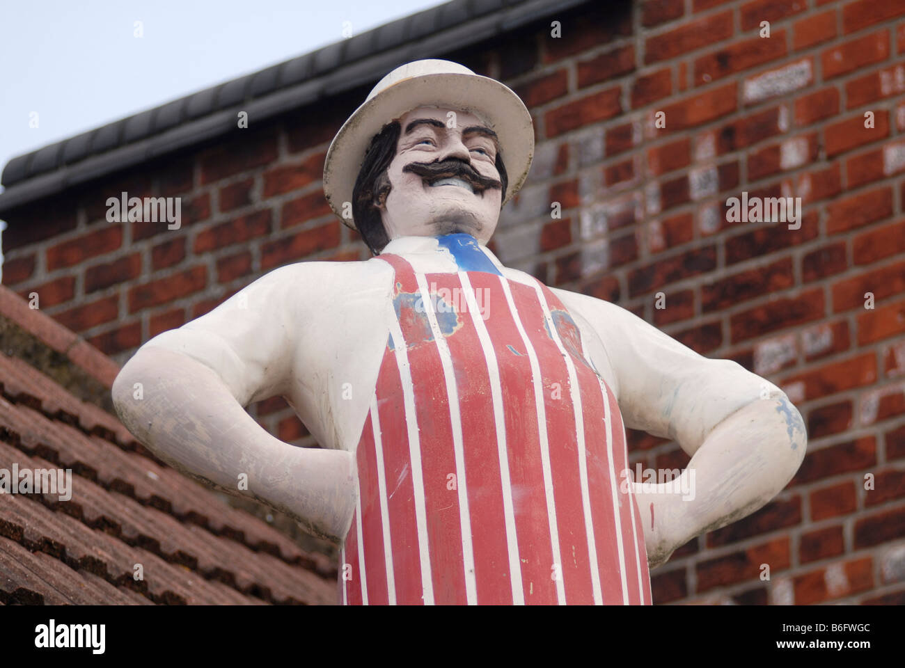 Model of a butcher outside a butchers shop in Bedford UK 2008 - Stock Image