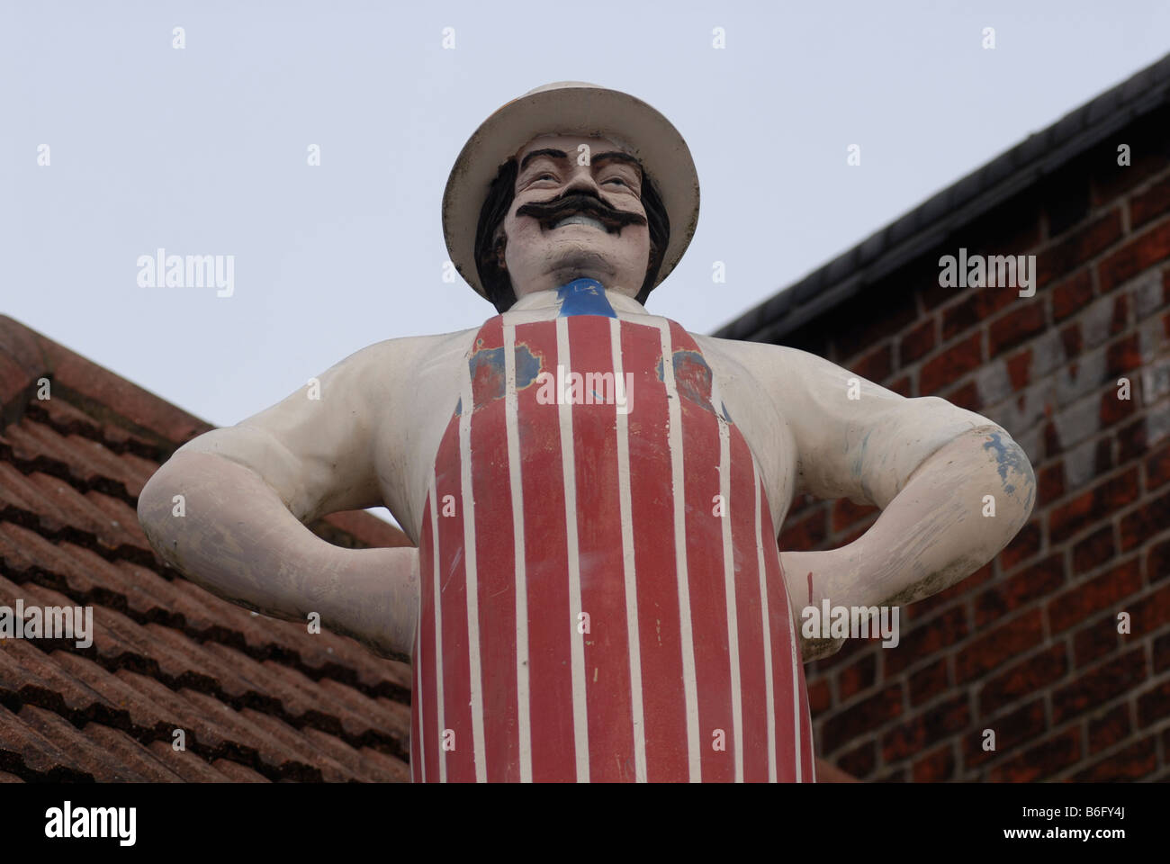 Model of a butcher above a butcher s shop in Bedford UK 2008 - Stock Image