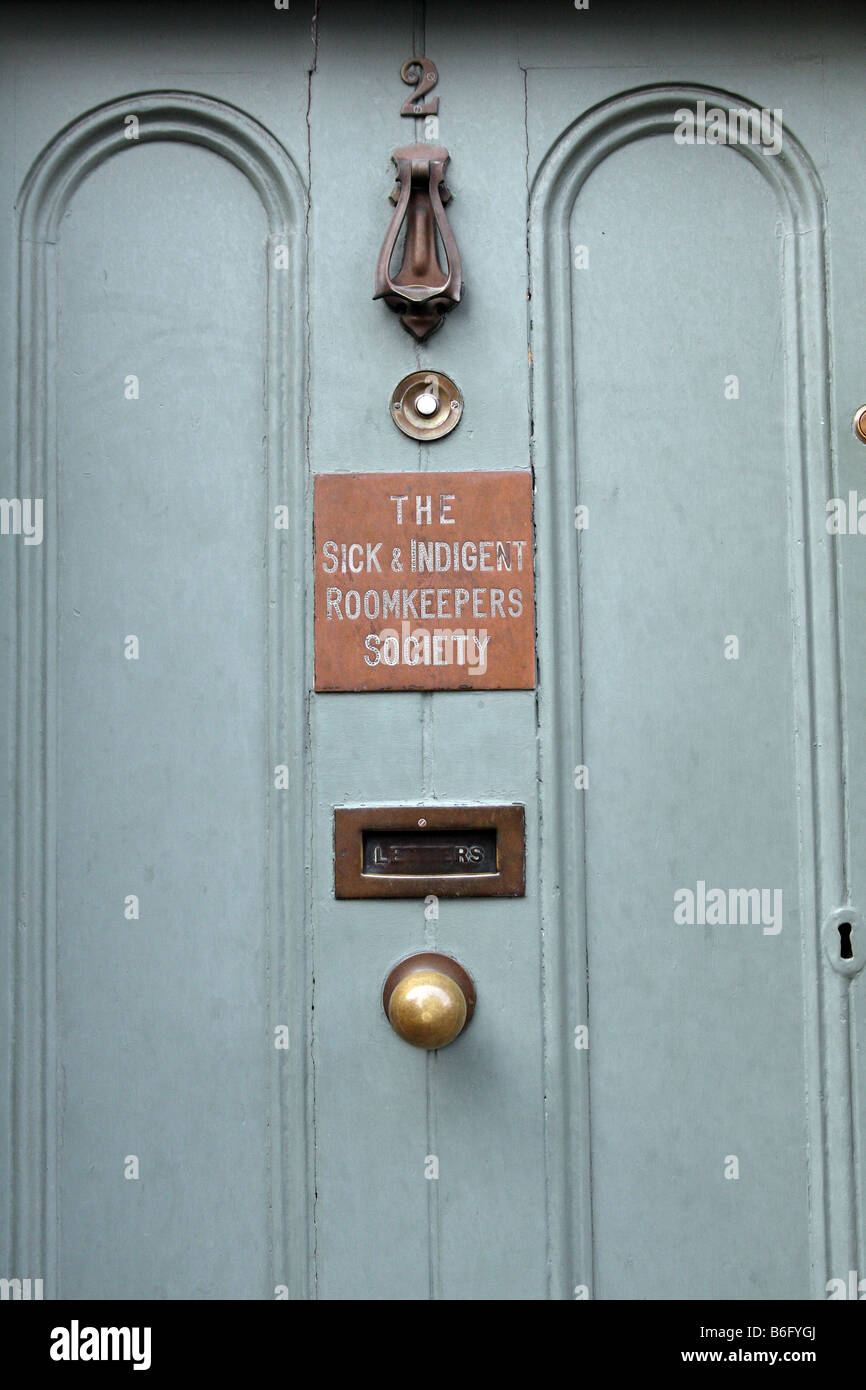The door to the Sick and Indigent Roomkeepers Society in the city of Dublin in the Republic of Ireland - Stock Image