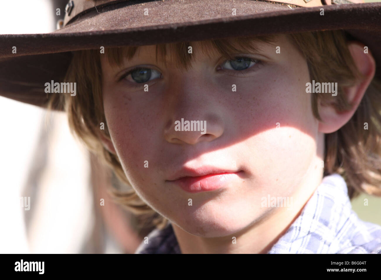 A young cowboy in his cowboy hat - Stock Image