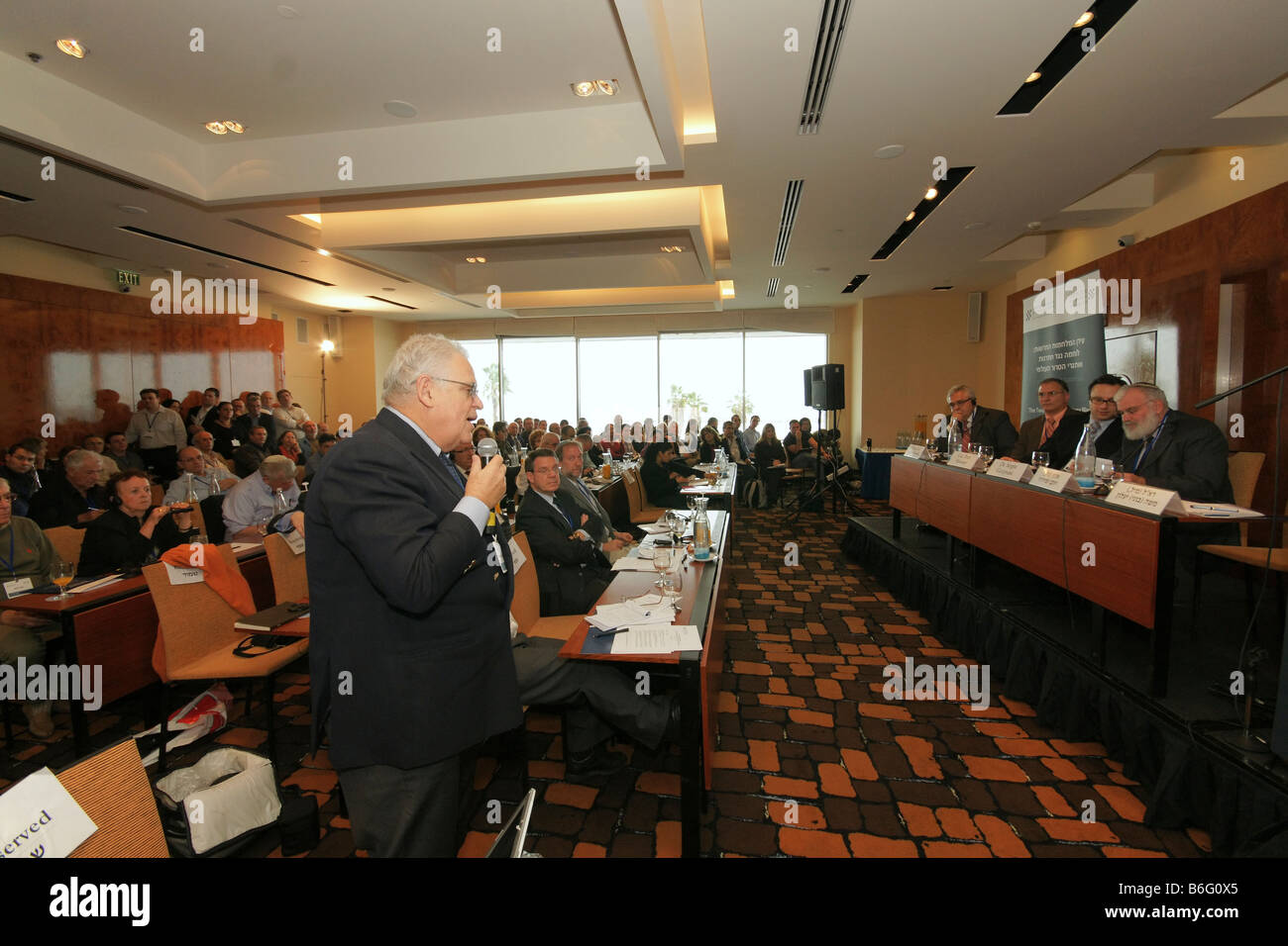 Renown strategist prof. Edward Luttwak asks a question during the Adelson Institute Dec. 2008 Counterinsurgency Stock Photo