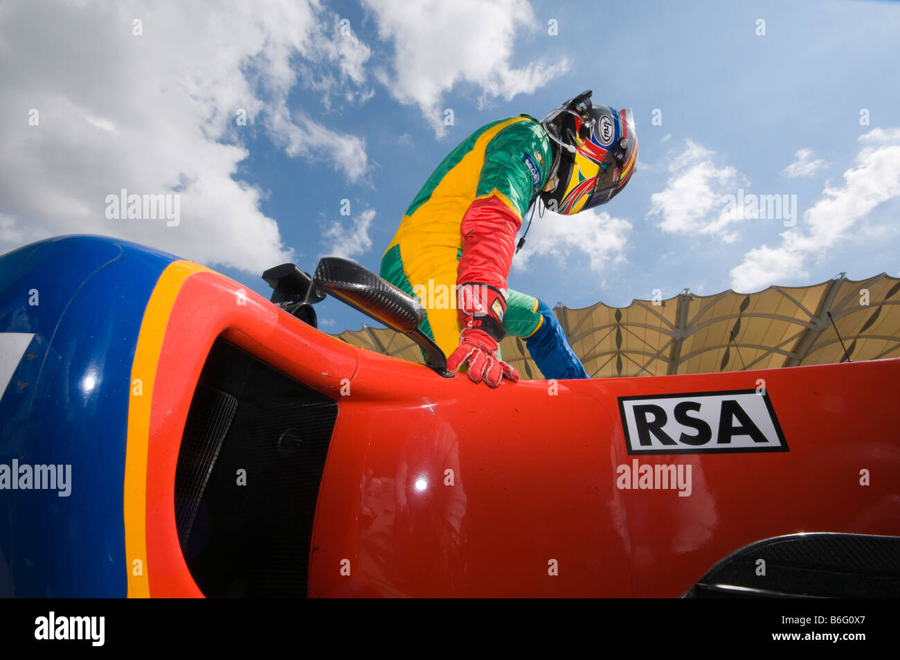 Driver Adrian Zaugg of A1 Team South Africa exits his car after qualifying session at A1GP World Cup of Motorsport - Stock Image