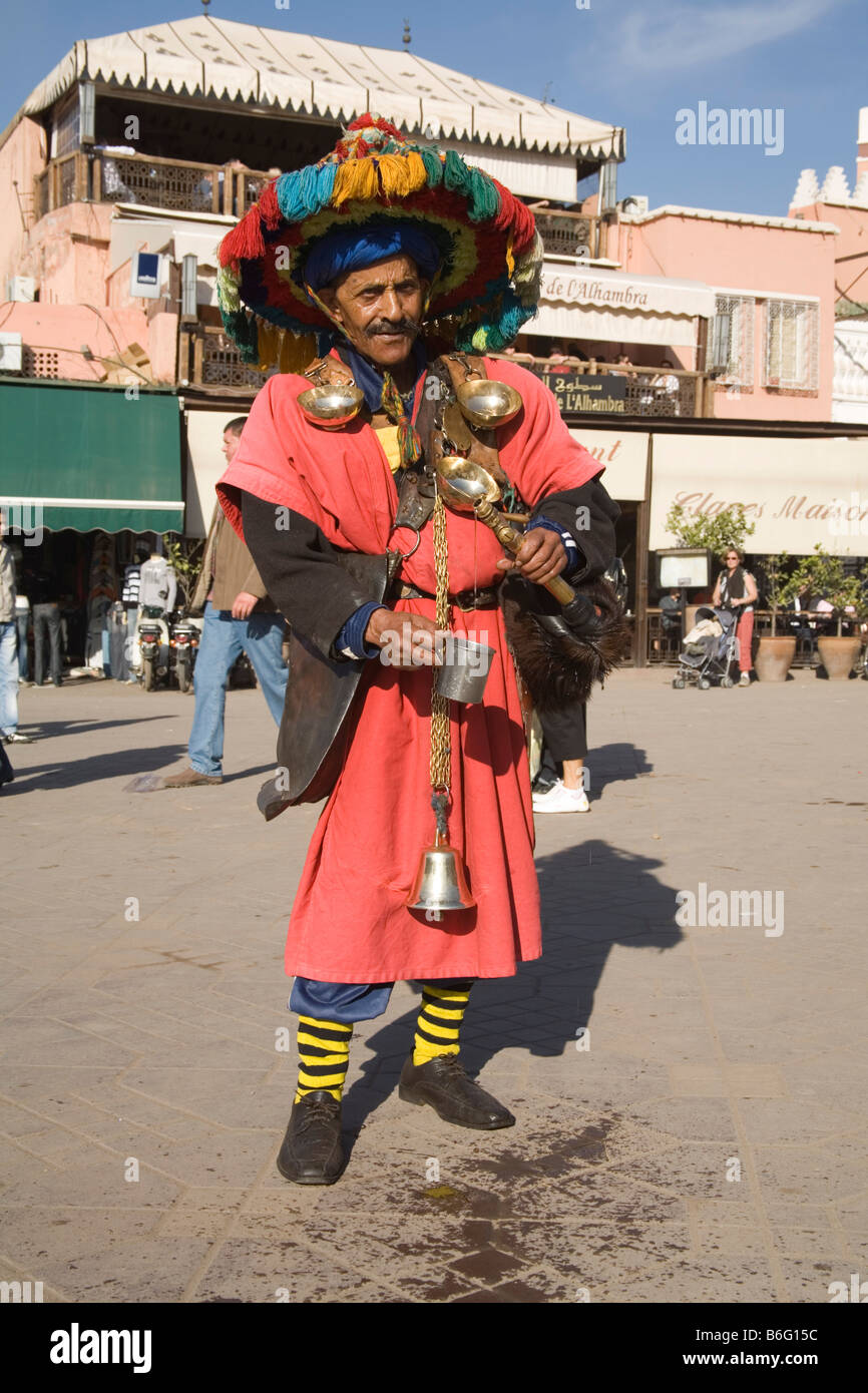 Marrakech Morocco North Africa December One of the colourfully dressed water carriers in Jemaa el Fna Stock Photo