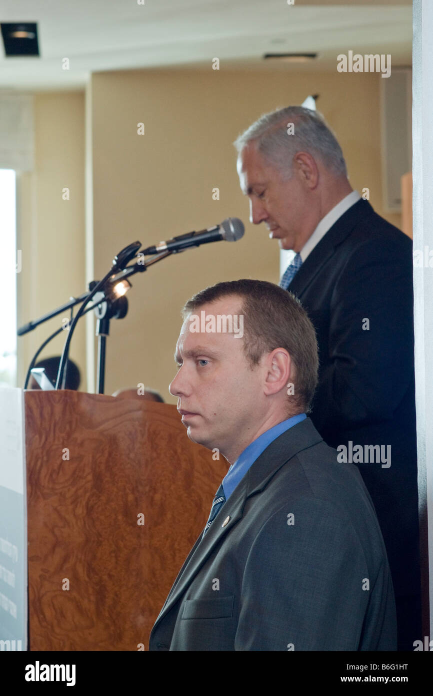 A Bodyguard stands alert as Binyamin Netnayahu,former Israeli PM, speaks at the Adelson Institute's Counterinsurgency Stock Photo