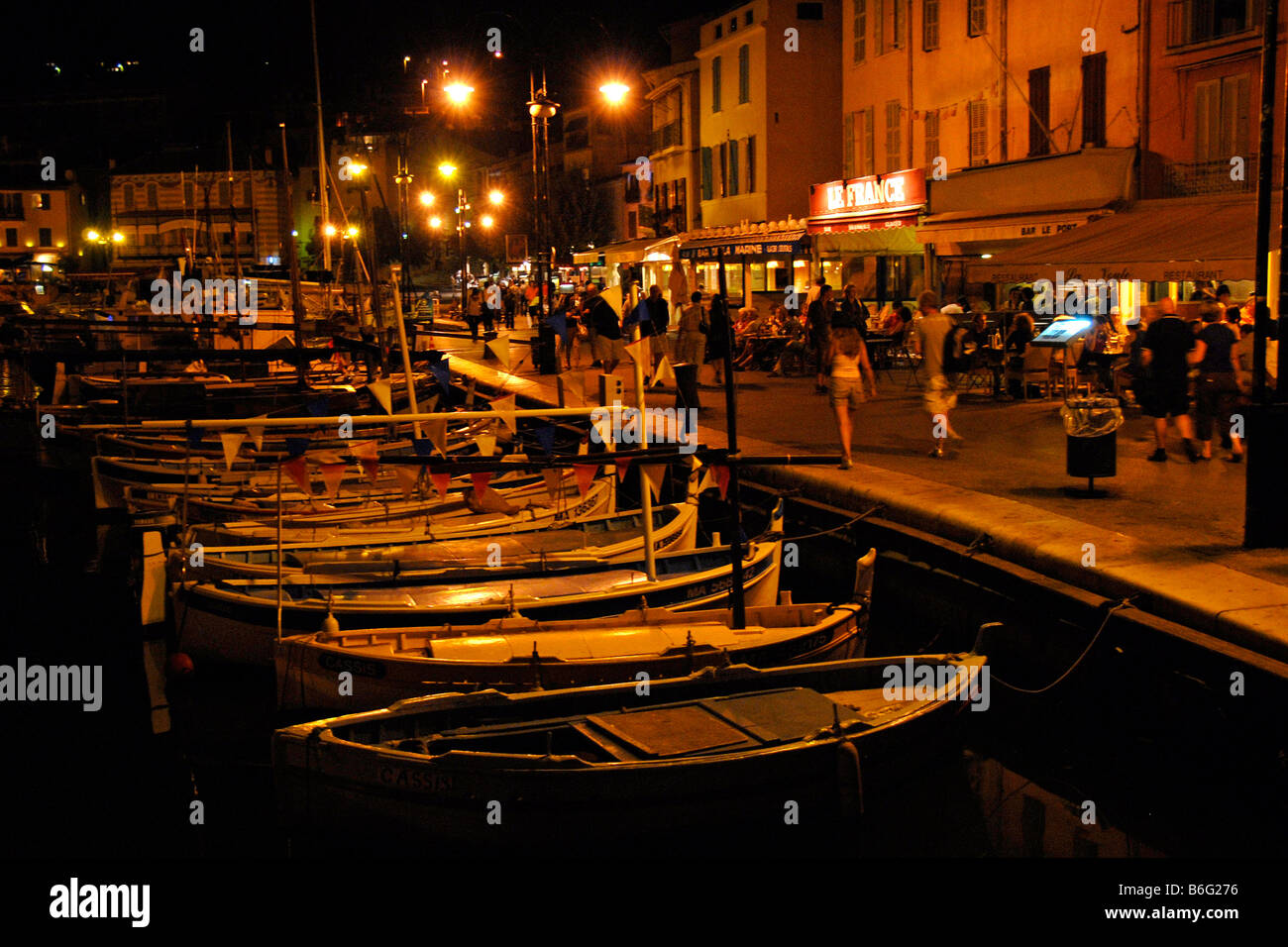 People Walking Along Harbour At Night Cassis Provence France