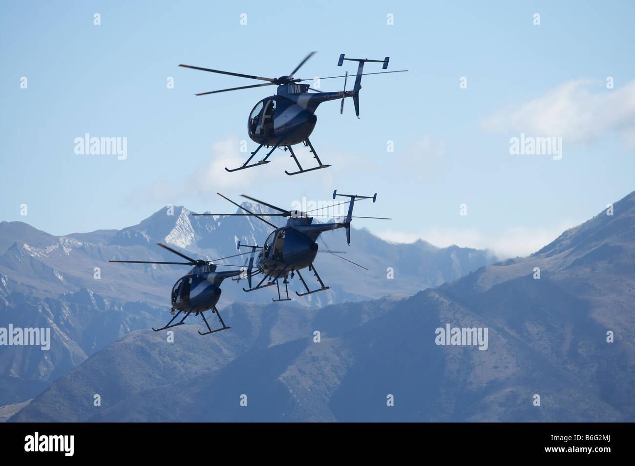 Hughes 500s Warbirds over Wanaka Airshow Wanaka South Island New Zealand - Stock Image