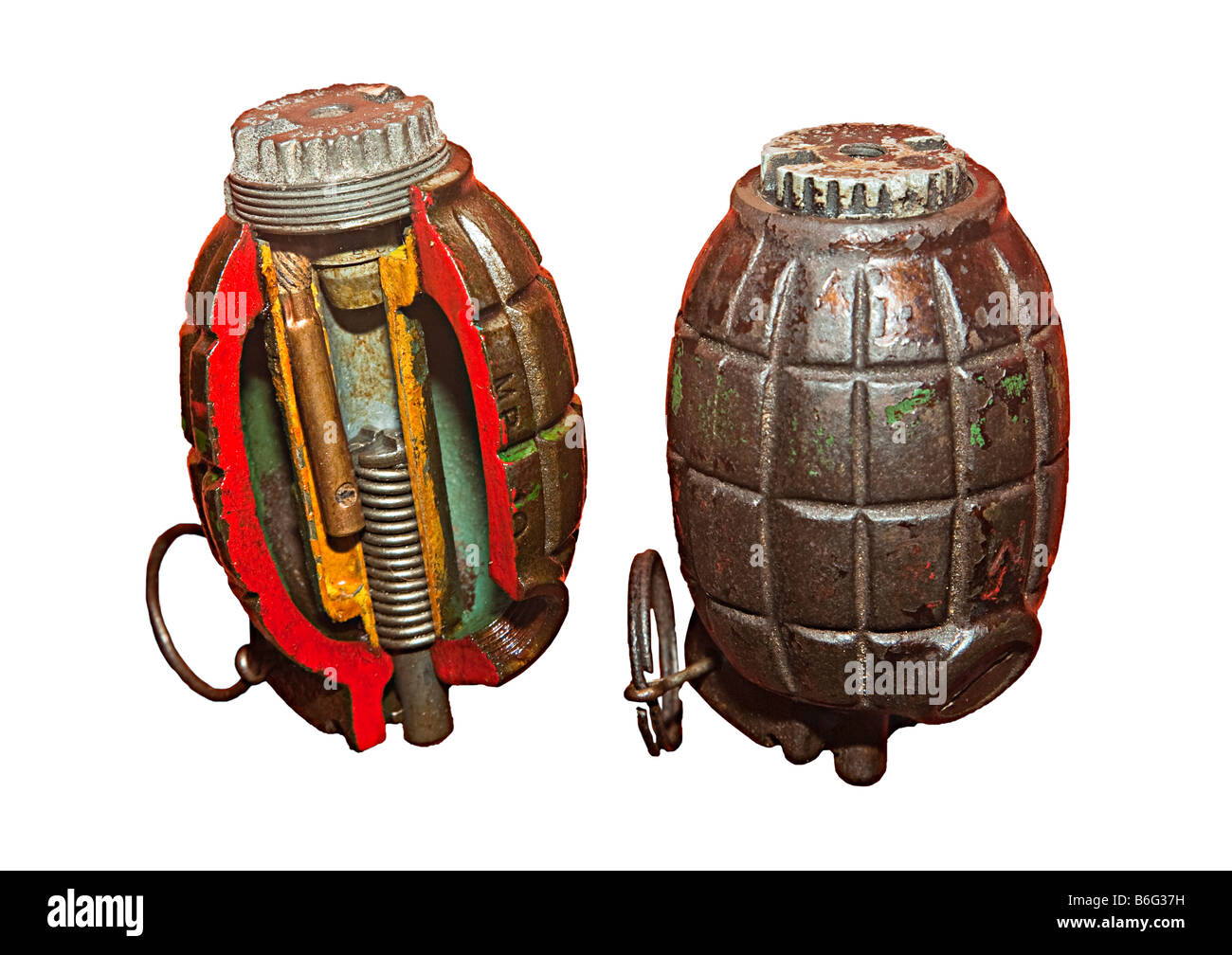 Mills bomb grenade as used by British army in the world wars cutaway and whole - Stock Image