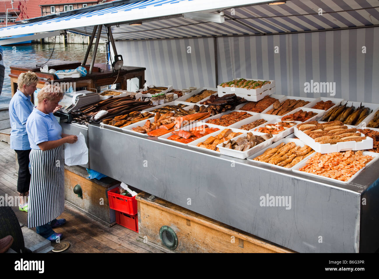 Selling fish on the harbour quay Wismar Germany - Stock Image