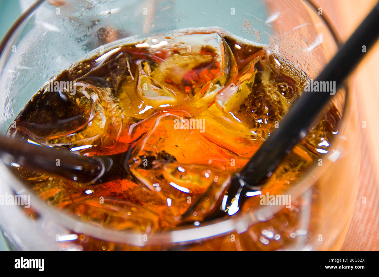 Rum and coke with ice in a glass - Stock Image