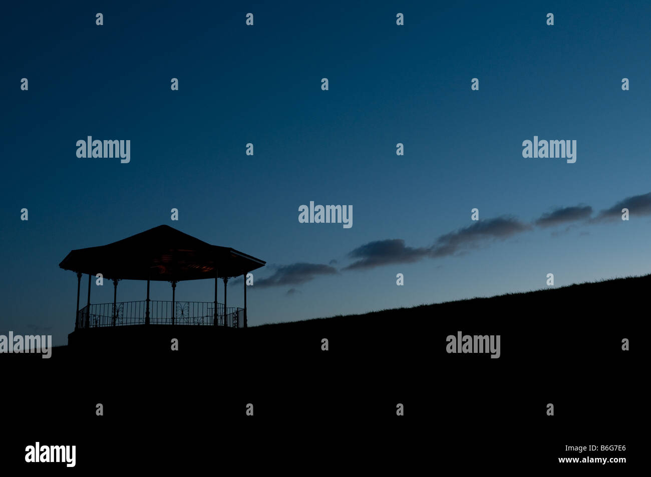 The silhouette of the empty victorian bandstand at night Llandeilo Carmarthenshire Wales UK - Stock Image