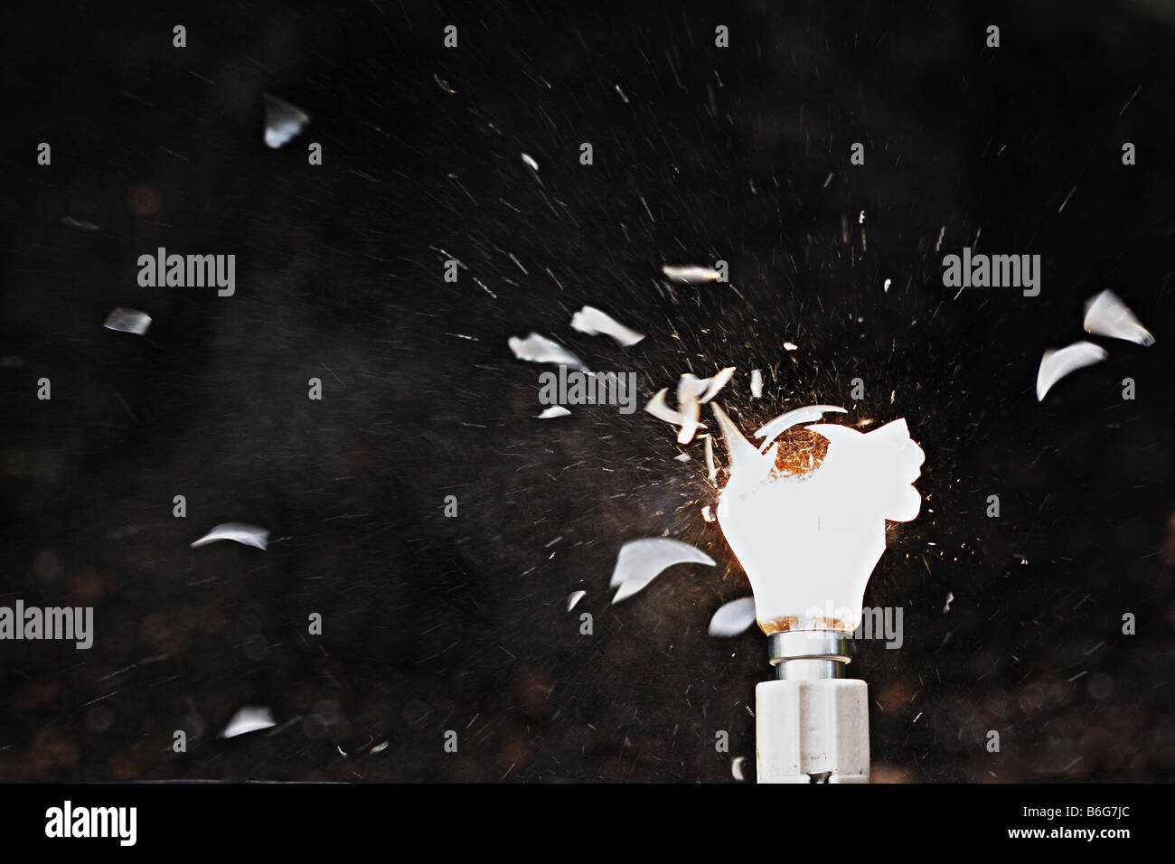 Exploding light bulb - Stock Image