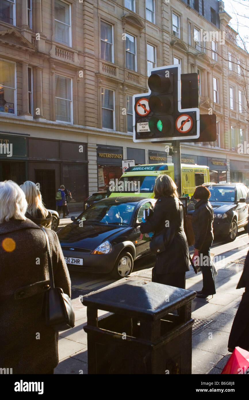 an ambulance struggles to get through Traffic congestion on Deansgate Manchester - Stock Image