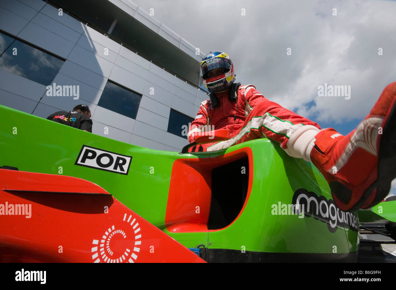 Driver Filipe Albuquerque of A1 Team Portugal exits his car after qualifying session at A1GP World Cup of Motorsport - Stock Image