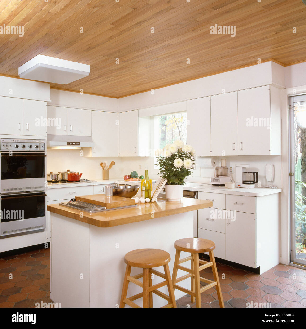 White Kitchen Units With Oak Worktop: Wooden Stools At Island Unit With Wooden Worktop In Modern
