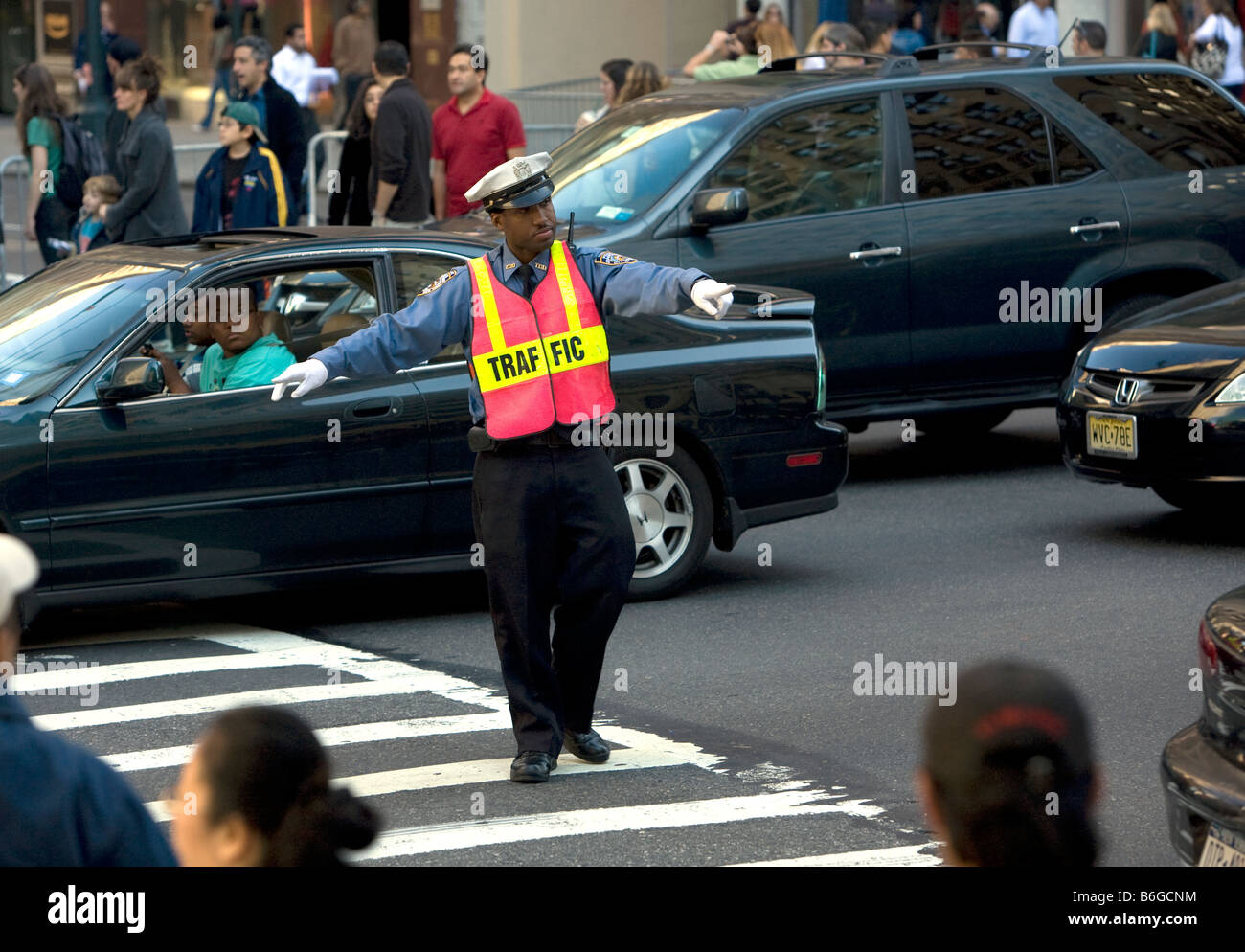 Traffic cop 42nd Street and Fifth Avenue New York City - Stock Image