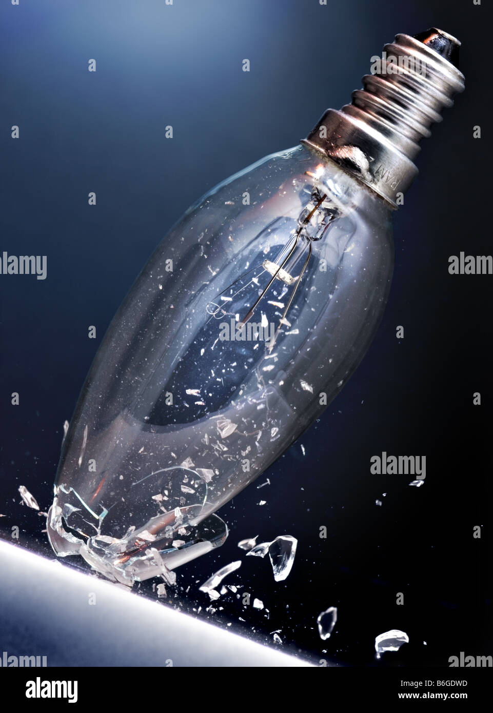 Light bulb hits marble floor - Stock Image