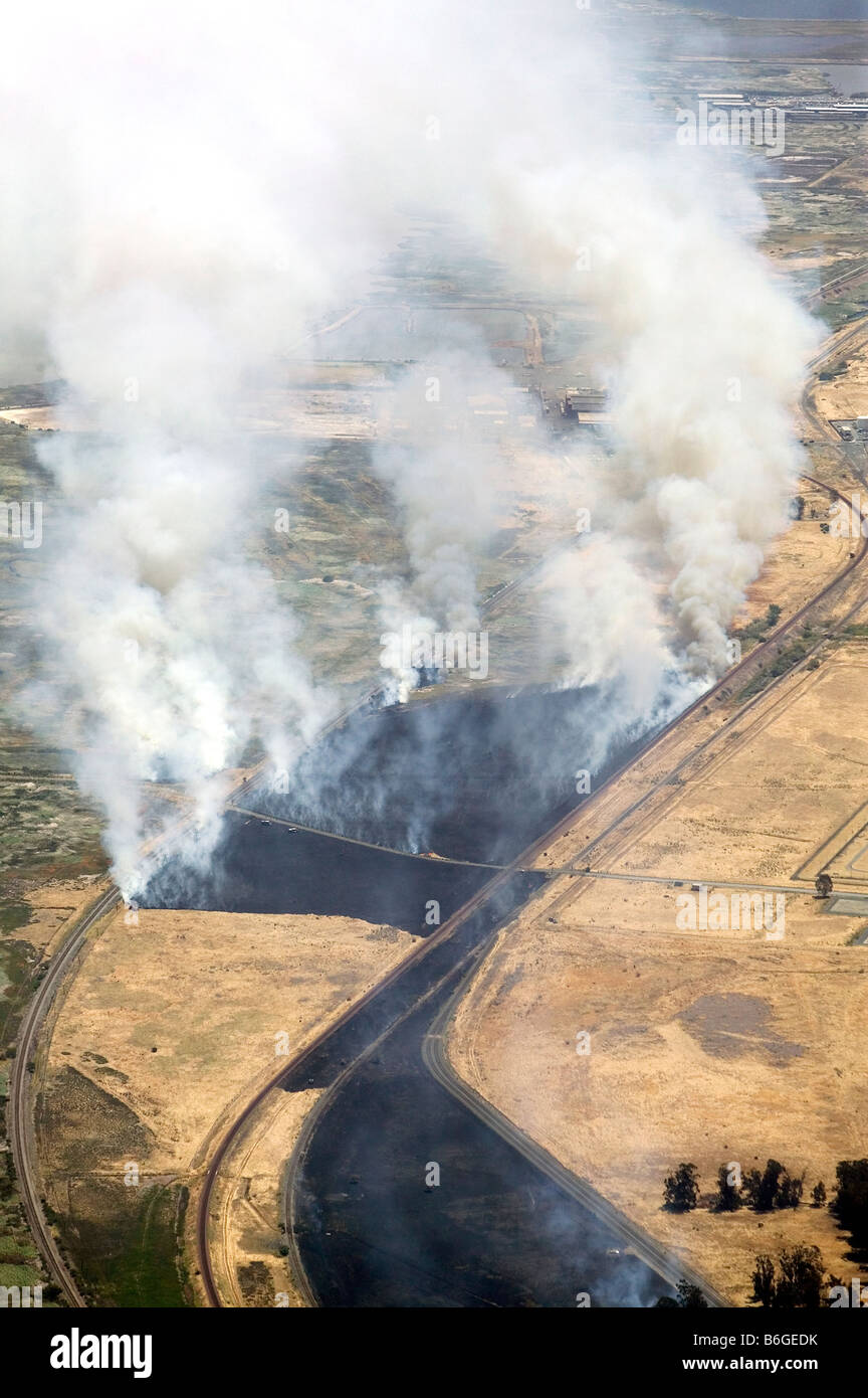 aerial view above smoke from controlled burn fire at California rail lines - Stock Image