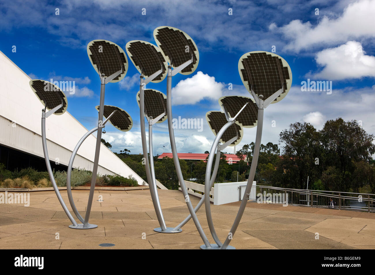 Solar panels sculpted as Mallee Trees harvest the sun's energy in front of the Adelaide Festival Center, South - Stock Image