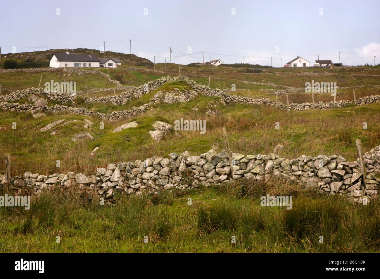 Stone walls and fields, Doonloughan, Connemara, Republic of Ireland - Stock Image