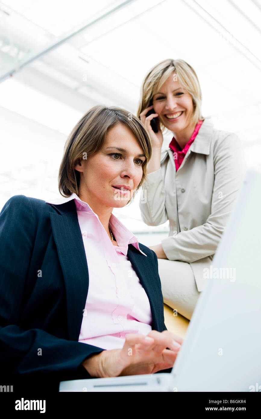 Two women looking at display - Stock Image