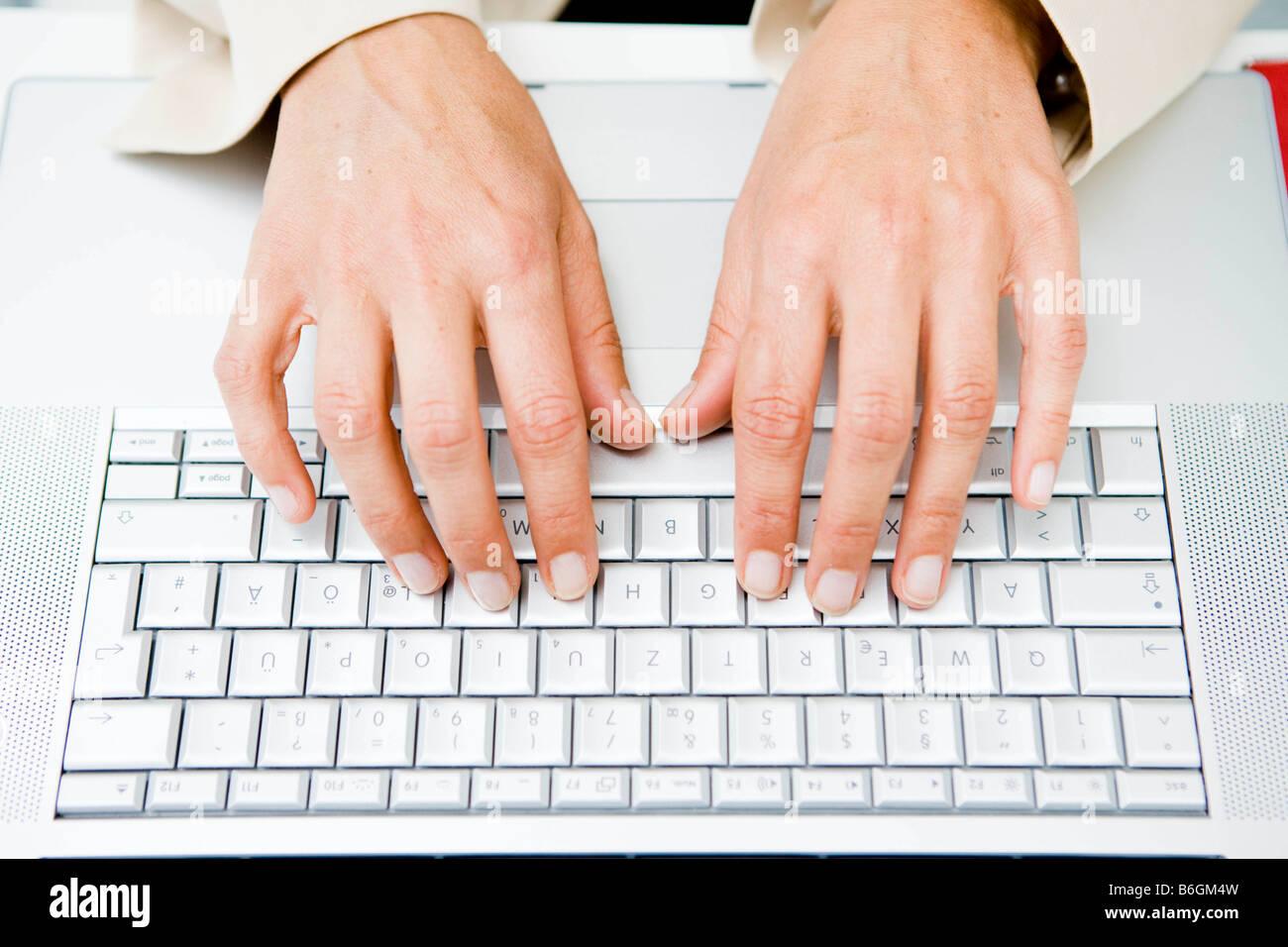 Pair of hands at keyboard - Stock Image