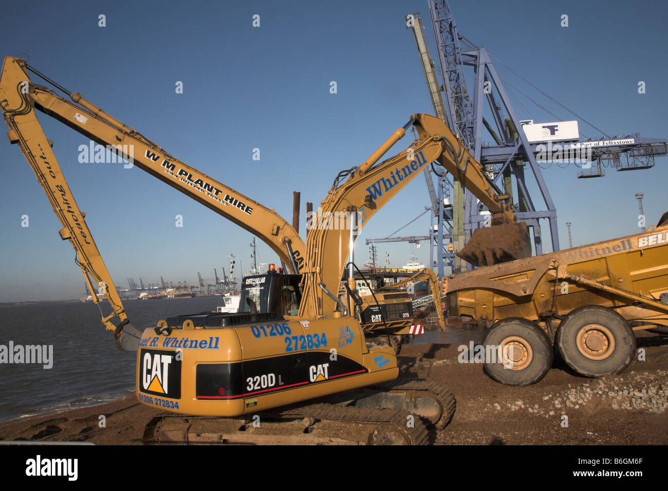 JCB diggers excavating Port of Felixstowe Suffolk England - Stock Image