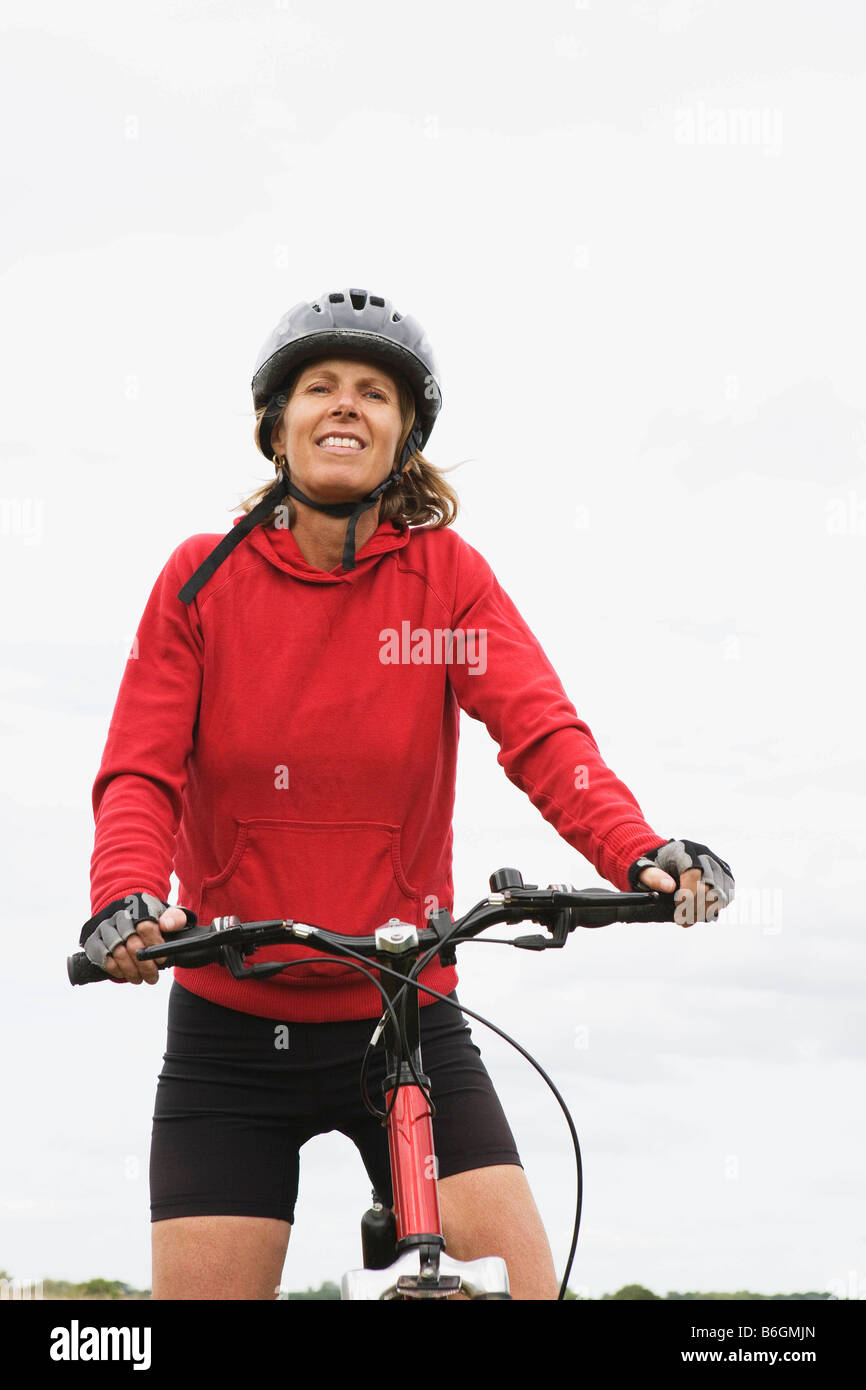 Woman cyclist on bicycle Stock Photo