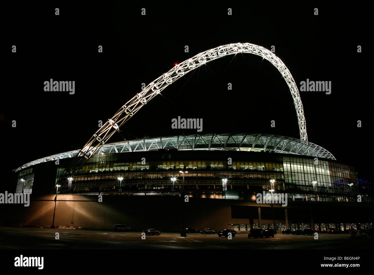 View of the new Wembley Stadium lit up at night - Stock Image