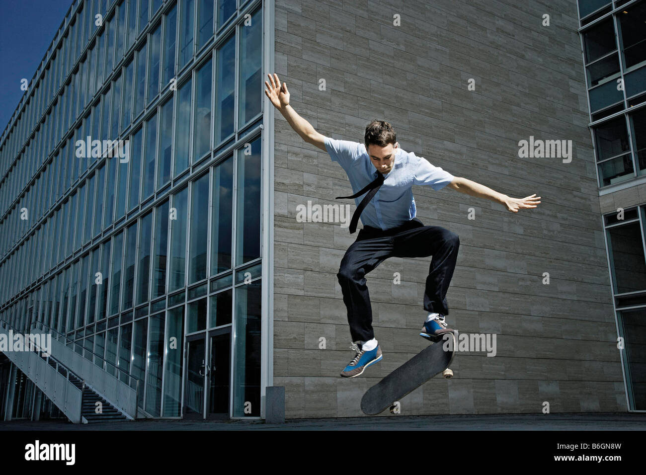 Skateboarder showing off his skills Stock Photo