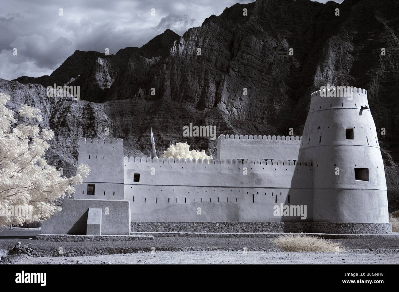 Infrared picture of Bukha Fort, Musandam, Oman using false colour and channel swapping Stock Photo